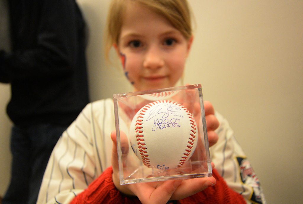 . Morgan Haffenden, 8 years-old, shows off her autographed baseball while attending Twinsfest with her parents at Target Field, Saturday, January 25, 2014(Pioneer Press: John Autey)
