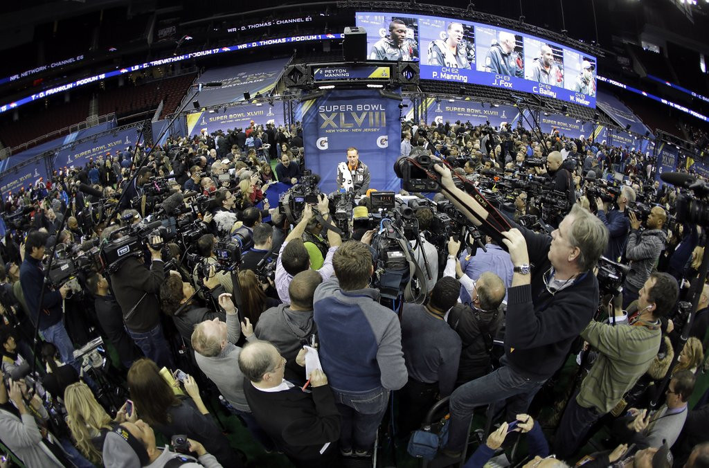 """. <p><b> Super Bowl Media Day took the spotlight Tuesday in New Jersey. It�s the annual reminder that the nation�s sports media is � </b> <p> A. Obsessed with football�s championship game <p> B. Growing exponentially each year <p> C. Somewhere between bacteria and leeches on the food chain <p><b><a href=\'http://blogs.twincities.com/sansevereshuddle/2014/01/28/media-day-can-mean-madness/\' target=\""""_blank\"""">HUH?</a></b> <p>   (AP Photo/Jeff Roberson)"""