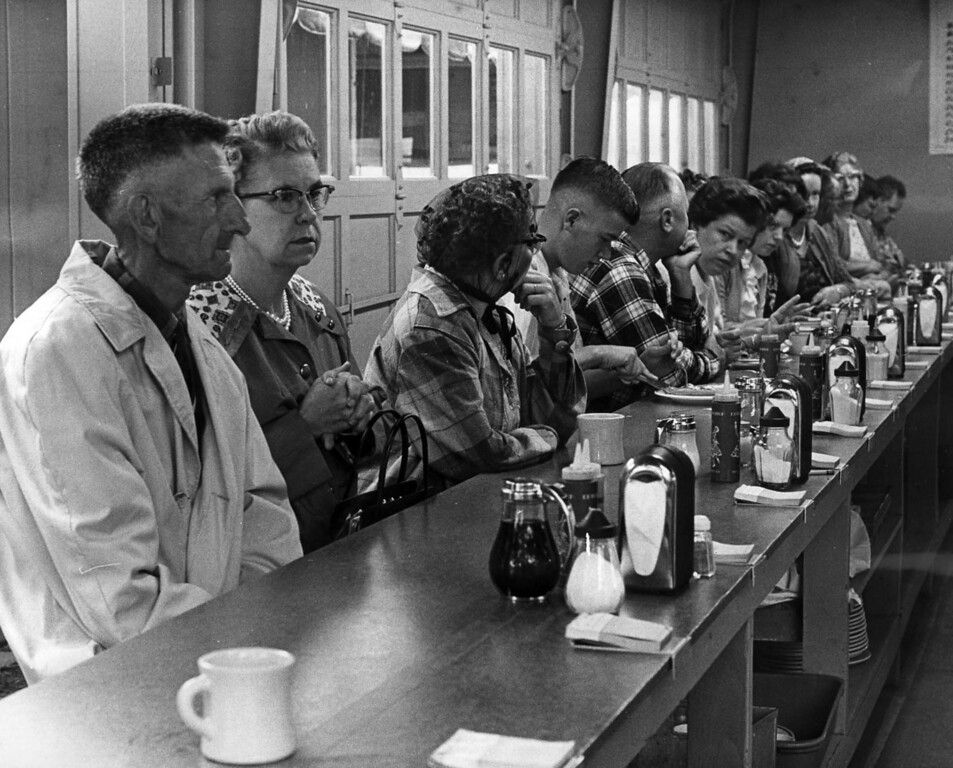". ""The hot food concessions -- especially hot waffles, and such, filled up early with heavily-clad eaters, seeking warmth, within and without\"" read this caption from a Aug. 24, 1963 St. Paul Dispatch photograph. Photo courtesy of the Minnesota State Fair."