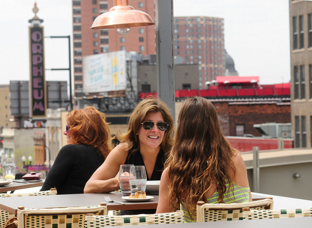 . Cheri Lange and her daughter Lorelei, right, enjoy lunch overlooking Hennepin Avenue at the Union Restaurant\'s third-floor patio in Minneapolis, on May 14, 2013. (Pioneer Press: Scott Takushi)