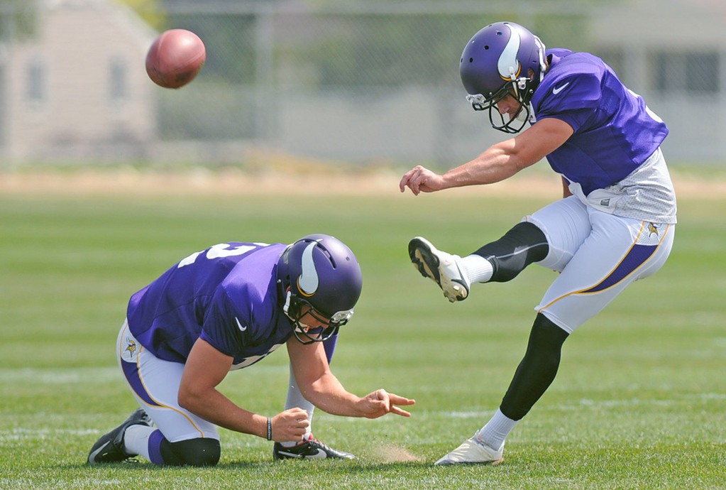 . Vikings punter Jeff Locke holds for kicker Blair Walsh during practice on the last day of training camp.  (Pioneer Press: Chris Polydoroff)