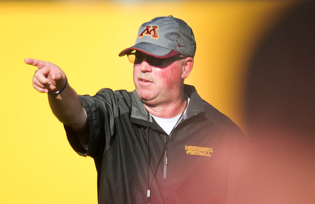 . Gophers head coach Jerry Kill motions to players. (Pioneer Press: Ben Garvin)