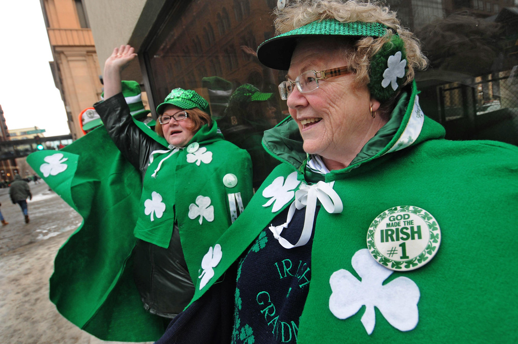 . The McCormick sisters Pat, left, and Mary Lee wave at friends along the annual St. Patrick\'s Day parade rout.  (Pioneer Press: Scott Takushi)