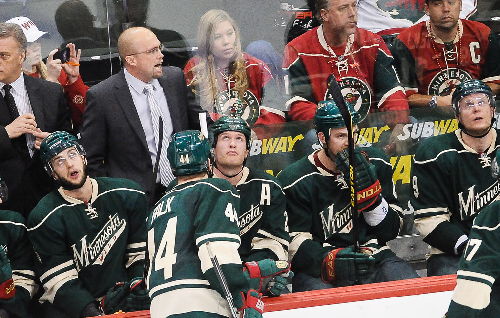 . Minnesota head coach Mike Yeo has a word with players during the second period against the Blackhawks.   (Pioneer Press: Ben Garvin)