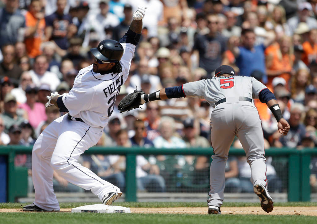 . Detroit Tigers\' Prince Fielder beats the throw from Minnesota Twins center fielder Aaron Hicks to shortstop Eduardo Escobar during the fourth inning. (AP Photo/Carlos Osorio)