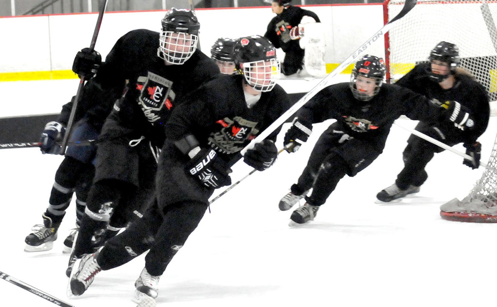 . High-school age male and female students work on their on-ice conditioning at Northern Educate Hockey Academy. (Pioneer Press: John Doman)