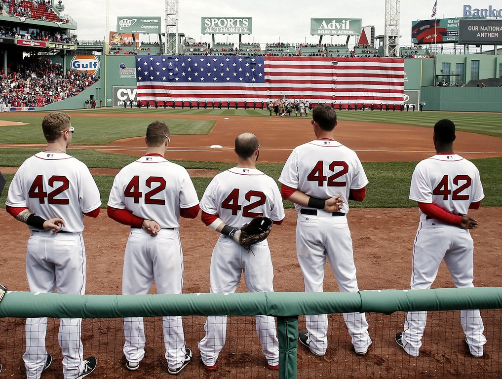 """. <p><b> All major league baseball players wore the number 42 during Wednesday�s games, paying tribute to � </b> <p> A. Jackie Robinson <p> B. Mariano Rivera  <p> C. The number of pitchers who have had Tommy John surgery this month <p><b><a href=\'http://www.usatoday.com/story/sports/mlb/2014/04/14/jackie-robinson-day-mlb-hank-aaron-racism-still-exists/7723045/\' target=\""""_blank\"""">HUH?</a></b> <p>    (AP Photo/Winslow Townson)"""