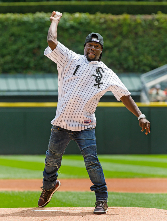 . Actor and comedian Kevin Hart throws a ceremonial first pitch before the Twins take on the White Sox. (AP Photo/Andrew A. Nelles)