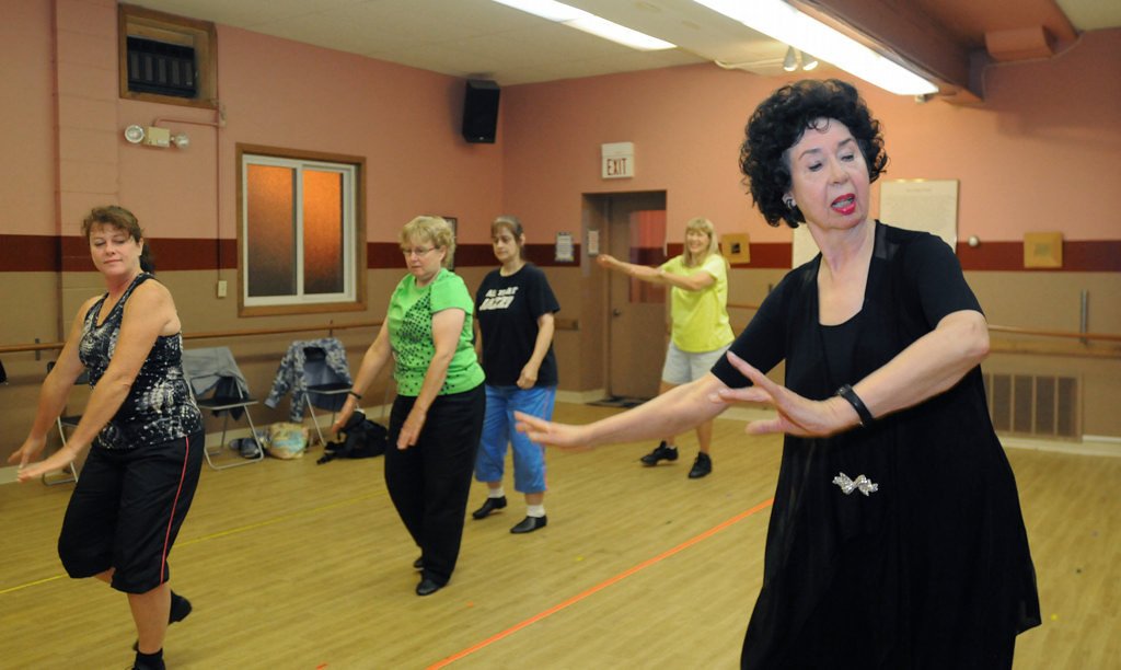 """. Nancy Raddatz, 77. leads an adult Tap-Jazz class in a jazz routine to the song \""""Freeze Frame.\""""  Students from left front are Mary Peterson, Mary Burrell,  Ann Gaetke, and Cindy Hedum. (Pioneer Press: Ginger Pinson)"""