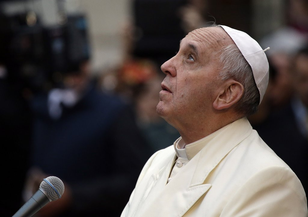". <p><b> Pope Francis caused many heads to turn when he revealed that he once worked as a � </b> <p> A. Nightclub bouncer <p> B. Male model <p> C. Contraceptive salesman <p><b><a href=\'http://religion.blogs.cnn.com/2013/12/03/pope-i-was-once-a-bar-bouncer/comment-page-4/\' target=""_blank\"">HUH?</a></b> <p>   (AP Photo/Gregorio Borgia)"