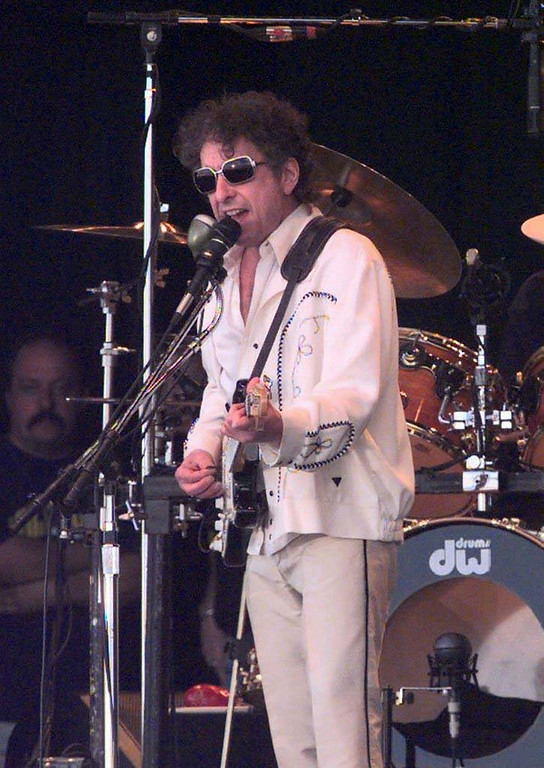 """. 1998: Bob Dylan performing at the open-air concert \""""Out in the Green\"""" on Sunday, July 12, 1998, in Frauenfeld Switzerland. 143.000 visitors came to the biggest open-air concert in Switzerland  (AP Photo/Keystone/Benno W. Bier)"""