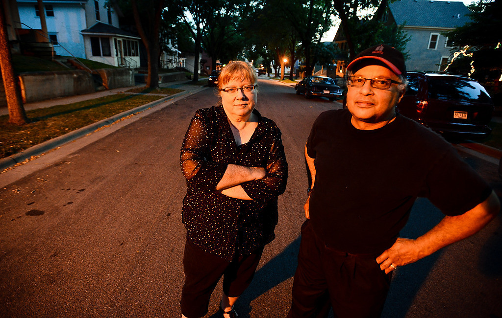""". For years, Jim Wardlaw and Holly Evans-Wardlaw have stood guard on the 600 block of St. Paul�s East Fourth Street. \""""At one time, I hated this neighborhood,\"""" James Wardlaw says. \""""But things are getting better.\"""" (Pioneer Press: Ben Garvin)"""