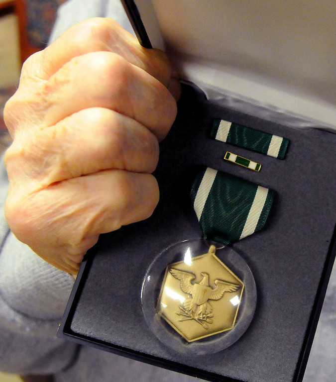 . Former Navy Capt. Charles Burrows, 95, shows his Navy Commendation medal, awarded for sustained acts of heroism, for his service in fourteen major naval operations aboard the battleship USS Tennessee during World War II.  (Pioneer Press: John Doman)