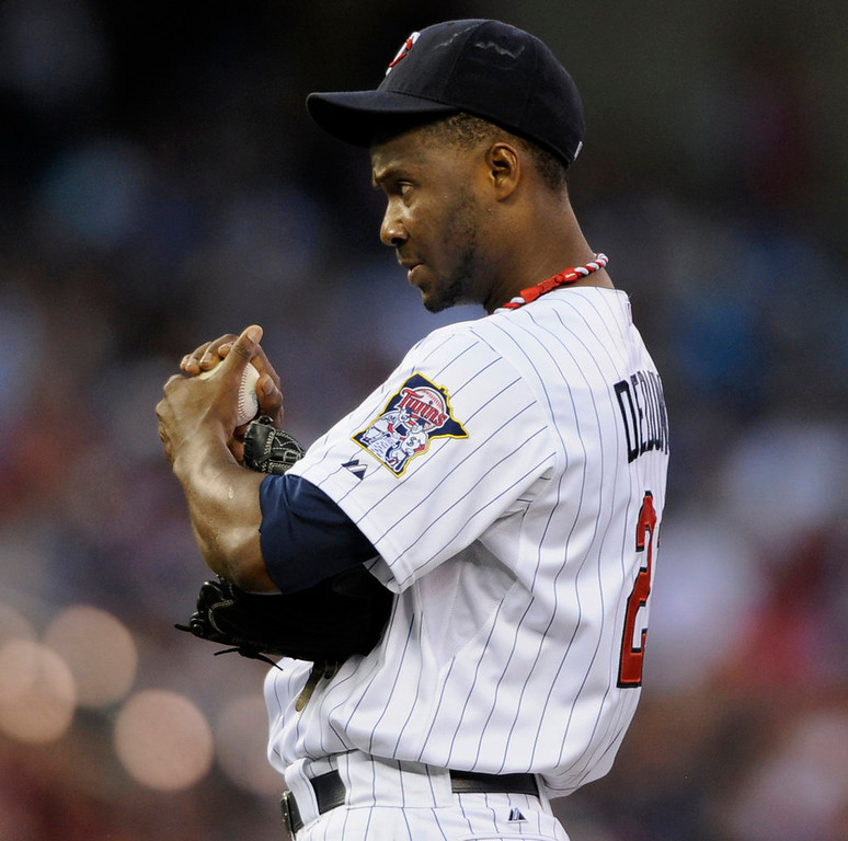 . Twins starting pitcher Samuel Deduno reacts during the fourth inning against the Cleveland Indians on Tuesday, Aug. 13, 2013, at Target Field. The Twins lost 5-2. (Photo by Hannah Foslien/Getty Images)