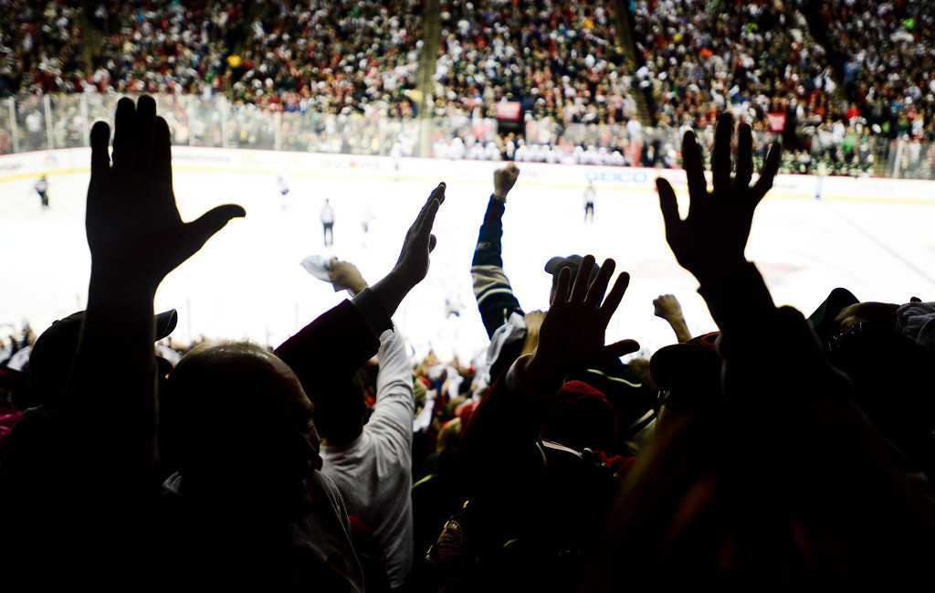 . Wild fans celebrate Zach Parise\'s game-tying goal in the third period against the Blackhawks.   (Pioneer Press: Ben Garvin)