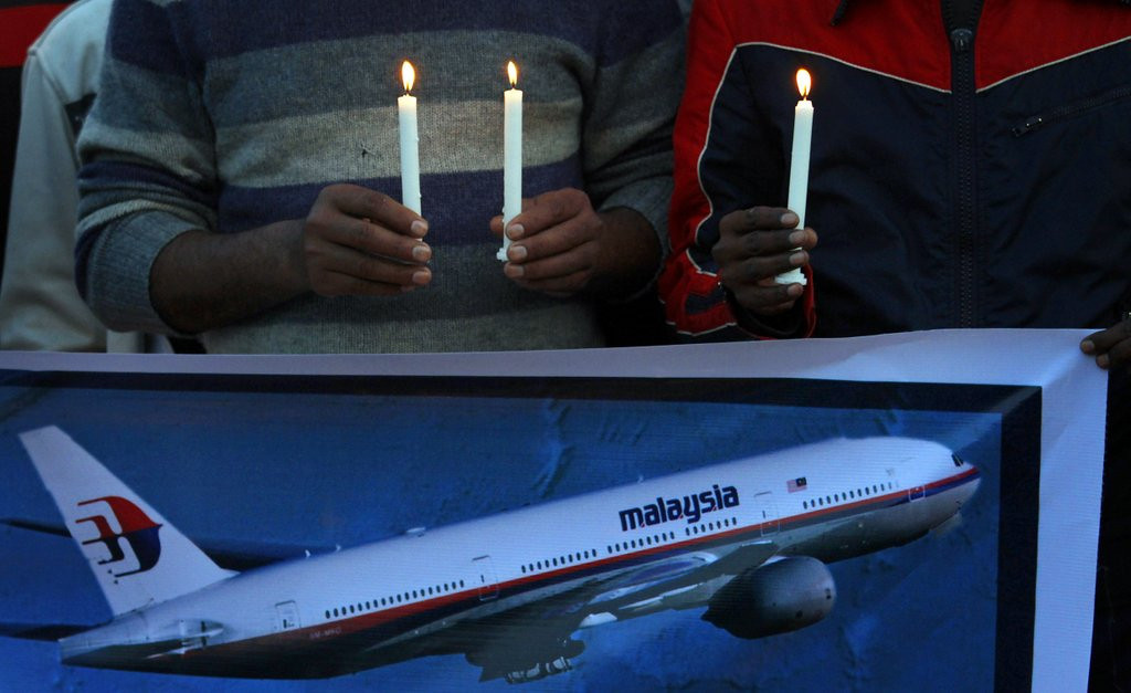 ". <p><b> Authorities announced on Monday that they believe this is now nearly five miles below the surface of the Indian Ocean � </b> <p> A. The wreckage of Malaysian Airlines Flight 370 <p> B. Amelia Earhart�s plane <p> C. CNN�s reputation <p><b><a href=\'http://www.twincities.com/breakingnews/ci_25408172/relatives-sob-after-announcement-missing-plane\' target=""_blank\"">HUH?</a></b> <p>    (AP Photo/Anjum Naveed)"