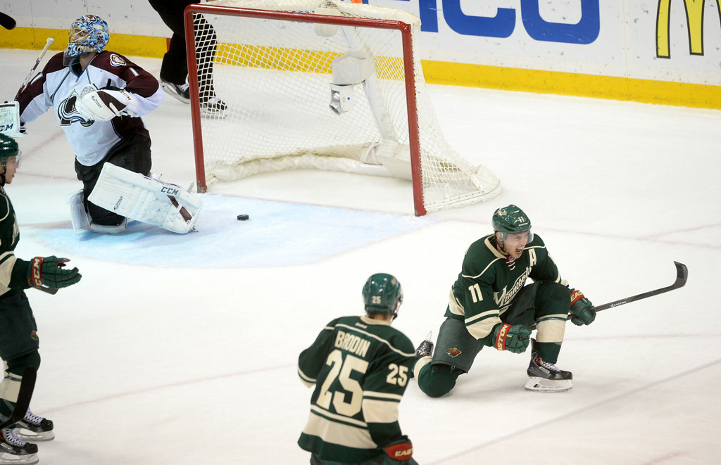 . Minnesota\'s Zach Parise, right, celebrates his goal during the third period with teammates Jonas Brodin, center, and Charlie Coyle.  (Pioneer Press: Sherri LaRose-Chiglo)