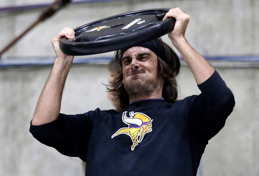 . Vikings punter Chris Kluwe strains during conditioning workouts on May 1, 2013. (Associated Press: Jim Mone)