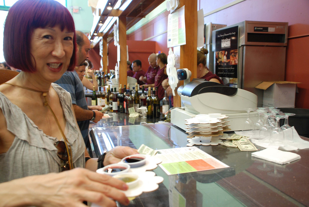 . A woman purchases wine samples during the 2010 Minnesota State Fair. Photo courtesy of the Minnesota State Fair.