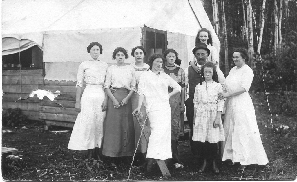 . The little treasuresFrom A LITTLE CANADIAN: �This photograph was taken around 1916-18, in Minneapolis, we think. The writing on the back identifies the front row as Mayme O�Malley, Helen O�Malley, Anna Mae Danaher, Florence Danaher and Mrs. Danaher, and the back row as Blanch Galvin, Ann O�Malley, Mr. Danaher and Dorothy Danaher. The O�Malleys and Blanch Galvin are my husband�s aunts, but we would like more information about the Danahers and where the photo was taken. Do any BB�ers know?�