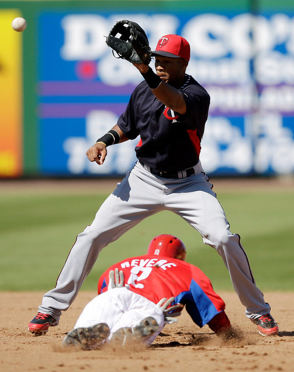 . Philadelphia\'s Ben Revere tries to steal second base as Minnesota\'s Pedro Florimon handles the throw in the fourth inning. (AP Photo/Matt Slocum)
