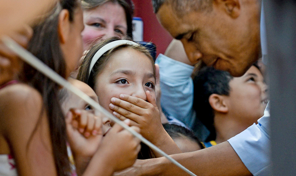 . A young admirer is momentarily overcome while meeting President Barack Obama outside Matt\'s Bar in Minneapolis on Thursday. (Pioneer Press: Ben Garvin)